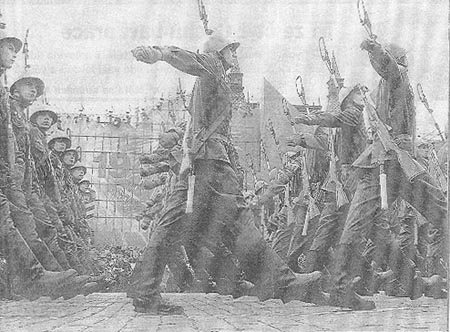 Victory day in moscow -- russian soldiers march by lenin mausoleum in